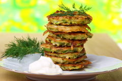 Zucchini fritters  with sour cream. Royalty Free Stock Photography
