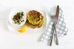 Zucchini fritters, vegetarian burger with coconut yogurt Stock Photos