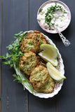 Zucchini fritters with yogurt dressing Royalty Free Stock Photos