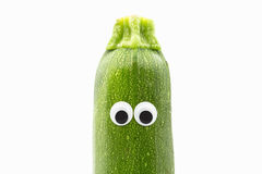 Zucchini with googly eyes on white background. Zucchini face Stock Image