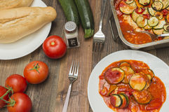 Zucchini gratin, baked, with tomatoes. Vegetables on the table Royalty Free Stock Photos