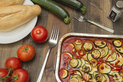 Zucchini gratin, baked, with tomatoes. Vegetables on the table Stock Image