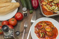 Zucchini gratin, baked, with tomatoes. Vegetables on the table Royalty Free Stock Images