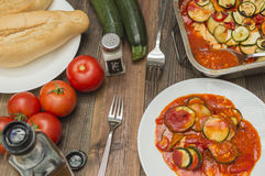 Zucchini gratin, baked, with tomatoes. Vegetables on the table Stock Images