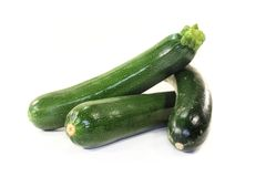 Zucchini. Green, raw zucchini in front of white background Stock Photography