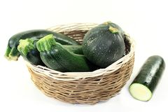 Zucchini. Green, raw zucchini in front of white background Stock Photo