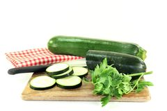 Zucchini. Green, raw zucchini in front of white background Royalty Free Stock Photography