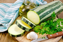 Zucchini green striped with garlic and oil Royalty Free Stock Photos