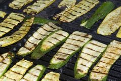 Zucchini on the Grill. Zucchini squash being cooked on a grill Royalty Free Stock Photos