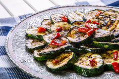 Zucchini. Grilled zucchini. Slices of grilled zucchini on a plate. Vegetarian - Mediterranean cuisine Royalty Free Stock Photos