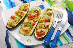 Zucchini halves stuffed with curry chicken Royalty Free Stock Photo