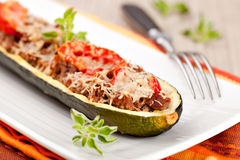 Zucchini halves stuffed with minced meat Stock Images