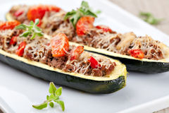 Zucchini halves stuffed with minced meat Stock Photo