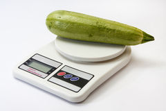 Zucchini on a kitchen digital scale Royalty Free Stock Photo