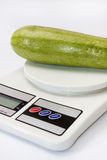 Zucchini on a kitchen digital scale Stock Image