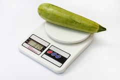 Zucchini on a kitchen digital scale Stock Photography