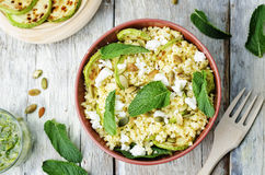 Zucchini, millet, mint, pumpkin seeds, goat cheese salad with co Royalty Free Stock Photos