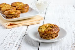 Zucchini muffins with herbs royalty free stock photos