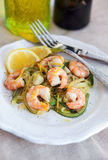 Zucchini noodles  with prawns and lemon zest Royalty Free Stock Photo