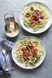Zucchini noodles with tomato sauce and mushrooms Royalty Free Stock Photography