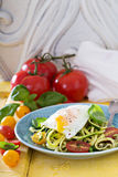 Zucchini noodles with tomatoes and egg Royalty Free Stock Photos