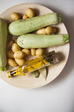 Zucchini with oil Royalty Free Stock Photography