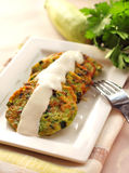 Zucchini pancakes with green onions and sour cream Stock Images