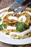 Zucchini pancakes with sour cream closeup on the table Royalty Free Stock Photo