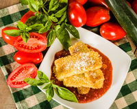Zucchini Parmesan dinner with basil Royalty Free Stock Image