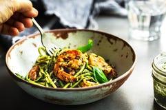 Zucchini pasta with Prawns in Basil Pesto sauce royalty free stock photo