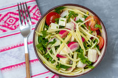 Zucchini pasta with tofu in a bowl. Love for a healthy vegan food concept Royalty Free Stock Image