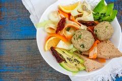 Zucchini pasta with tofu lentil balls, avocado, carrots. stock photo