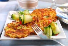 Zucchini and potato pancakes Stock Images
