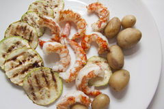 Zucchini, potato on prawns Royalty Free Stock Photos