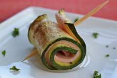 Zucchini roll. Fried zucchini roll with cooked ham Royalty Free Stock Photo