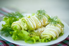 Zucchini rolls. With cheese stuffing and greens royalty free stock photos