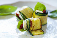 Zucchini rolls. With goat cheese, sun dried tomatoes and basil royalty free stock photos