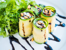 Zucchini rolls with mascarpone cheese, nuts, green salad and soy sauce Royalty Free Stock Photos