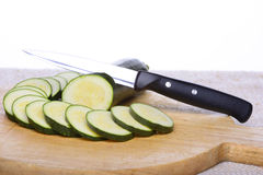 Zucchini. Round slices of zucchini arranged on a wooden tray Royalty Free Stock Photos