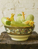 Zucchini in rustical bowl Stock Images