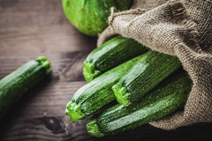 Zucchini in sack Stock Images