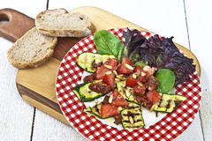 Zucchini Salad. Fresh summer salad with grilled zucchini and tomatoes Stock Photo