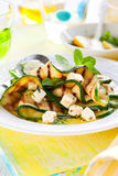 Zucchini salad. Grilled zucchini salad with feta,mint and lemon Royalty Free Stock Photos
