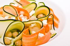 Zucchini salad with carrots, chickpeas and feta ch. Closeup with a zucchini salad with carrots, chickpeas and feta cheese stock photo