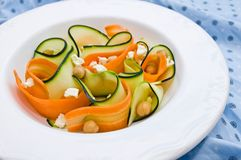 Zucchini salad with carrots, chickpeas and feta ch. Closeup with a zucchini salad with carrots, chickpeas and feta cheese stock image