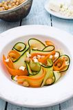 Zucchini salad with carrots, chickpeas and feta ch. Eese, on a wooden board royalty free stock image
