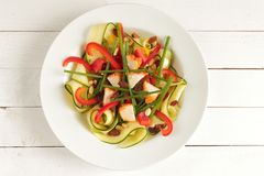 Zucchini salad with chve and chicken breast Royalty Free Stock Photo
