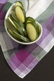 Zucchini sliced ​​on Pink Scottish plaid tablecloth. Stock Photos