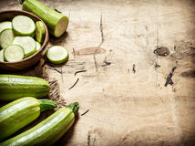 Zucchini sliced and whole of the old fabric. Royalty Free Stock Image