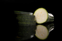 Zucchini slices on black background. Stock Image